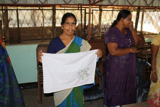 A Seamstress Supported by CERI Sells Pillowcases