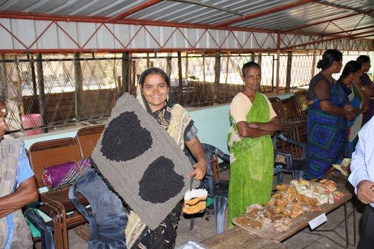 A CERI-supported potterer sells her merchandise