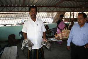 Sri Lankan fisherman sells dried fish