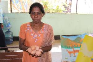 CERI Beneficiary Sells Chicken Eggs from Her Farm