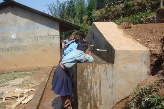 Students drinking water from newly constructed tap