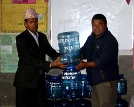 Handing over Water Jar's to School