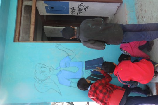 Painting outside the new toilet