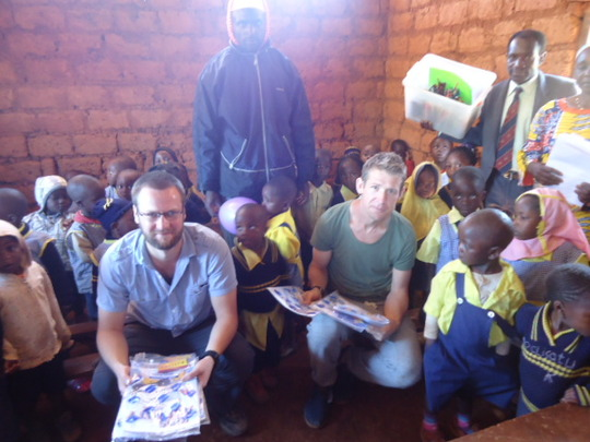 Director and volunteers offering gifts to the kids
