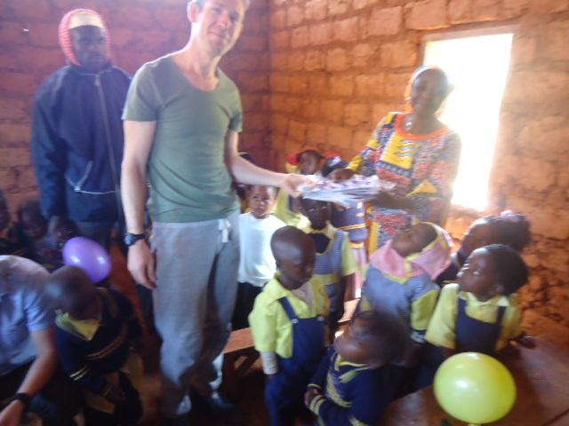 Volunteer handing gifts to the class teacher