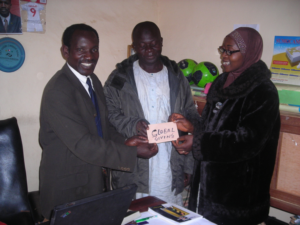 handing over  of the 25 USD to the P.T.A. chaiman