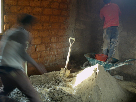 MIXING OF SAND /CEMENT FOR PLASTERING THE INSIDE