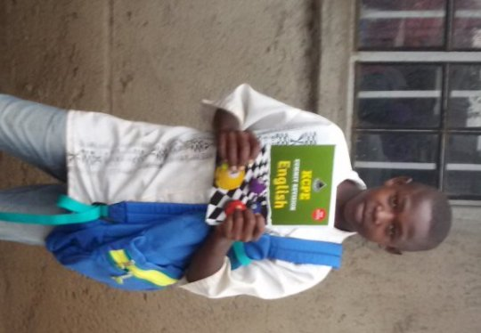 Our Number 1 Student receiving gifts