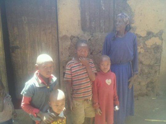 Margaret and her 4 grandchildren at her room
