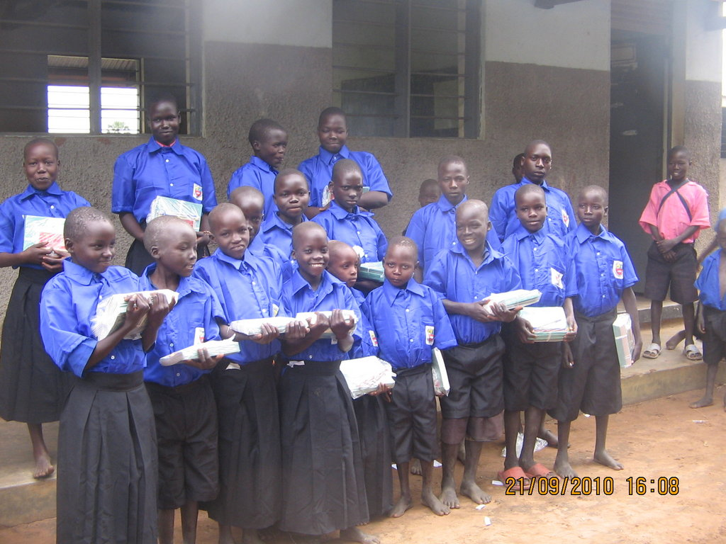 Children showing off their new school materials