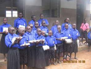 Children showing off their new school materials