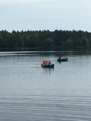 Canoe fun during Watershed Week at Camp Forest