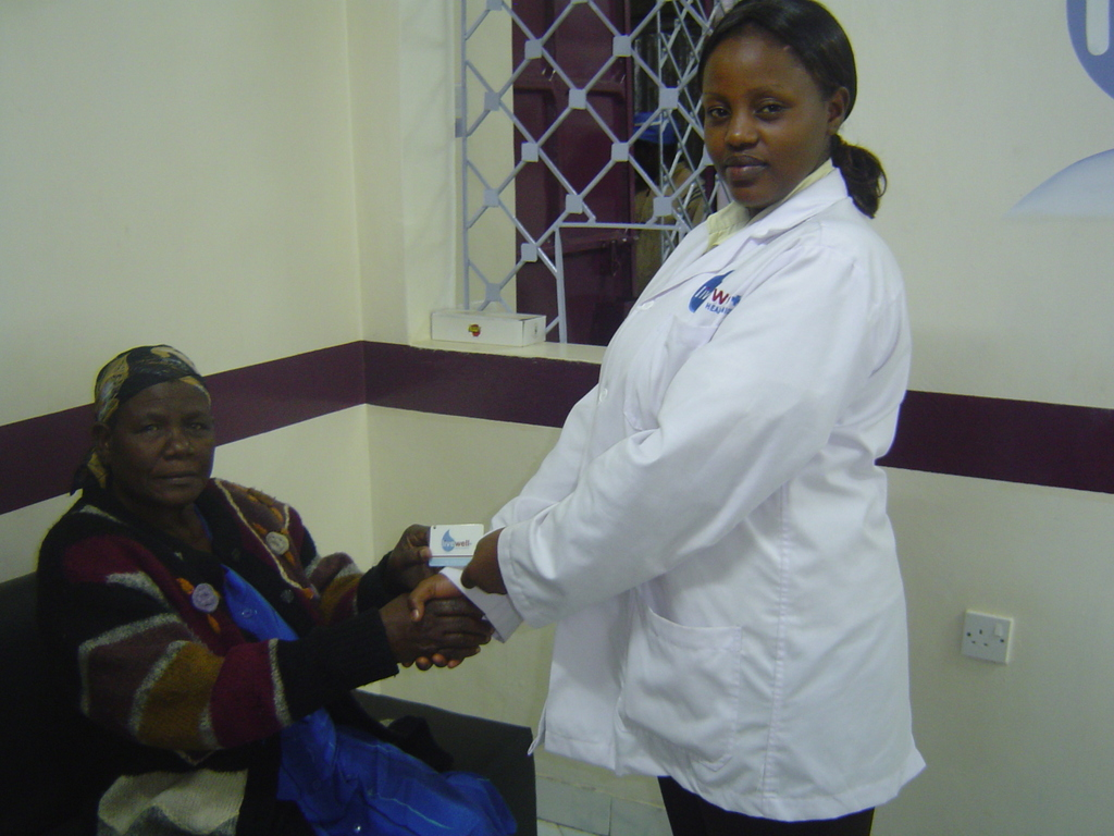 Lab Technician Catherine Wahu and Recipient
