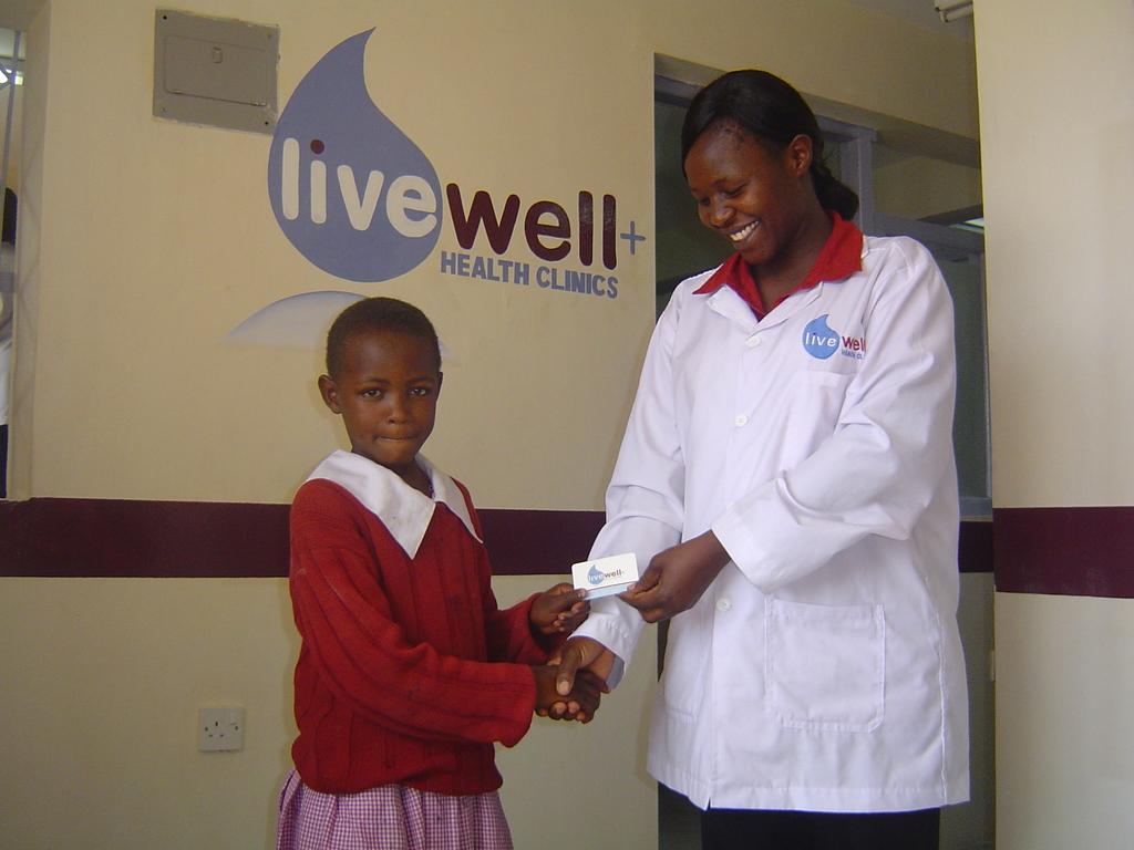 Nurse Helen Okumu and a LiveWell Card Recipient