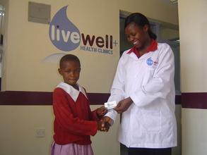 Nurse Helen Okumu and a LiveWell Card Recipient