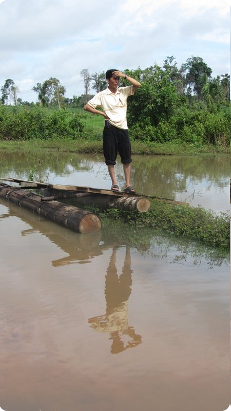 A man looks over a flooded area