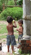 Some kids by Srey Phoom's rainwater storage.