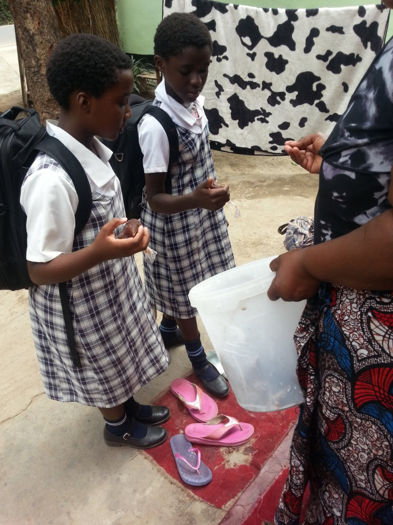 School girls buying from one of our entrepreneurs