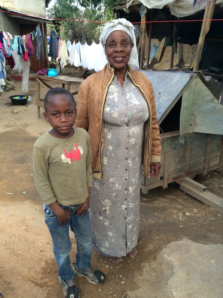 A loan recipient with her grandson