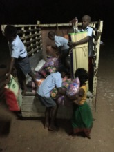 Some of the children helping unload new supplies.