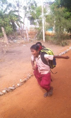 Happy Nandini with her new schoolbag