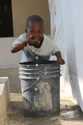 Washing his face with safe, treated water