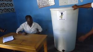 Director of school in Cite Soleil receives tank!