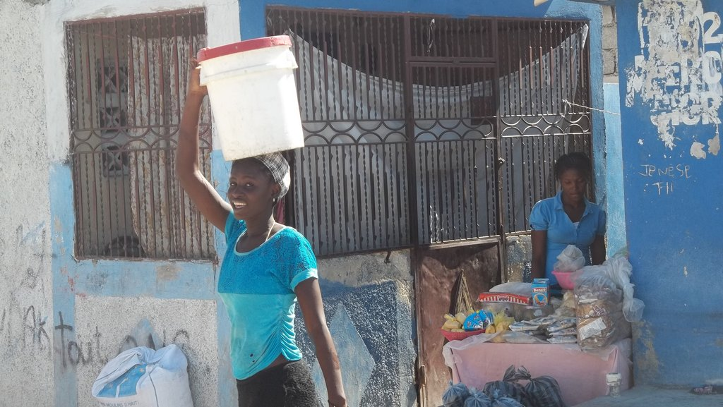 Lindsay carrying water to her home a mile away