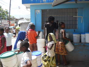 Waiting in line for hours to gather water