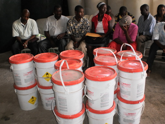 Cholera prevention training, chlorine distribution