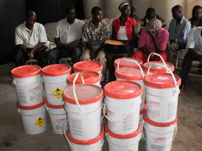 Cholera prevention training, chlorine distribution