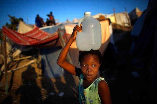 Girl carrying bucket