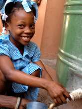 Abigail getting water at her school in Ti Goave