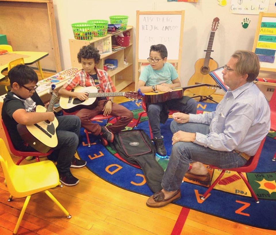 Scholar Athletes Enjoy Guitar Lessons w/ Coach Bob