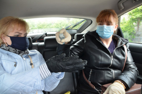 Lidia, left, and Vera, right, Sanitize Hands