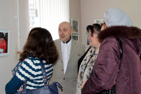 Alexandr and Visitors at Exhibition