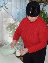 Claudia Pouring Milk