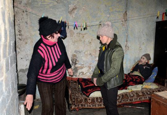 Galina checks Sergei & Liudmila's stove