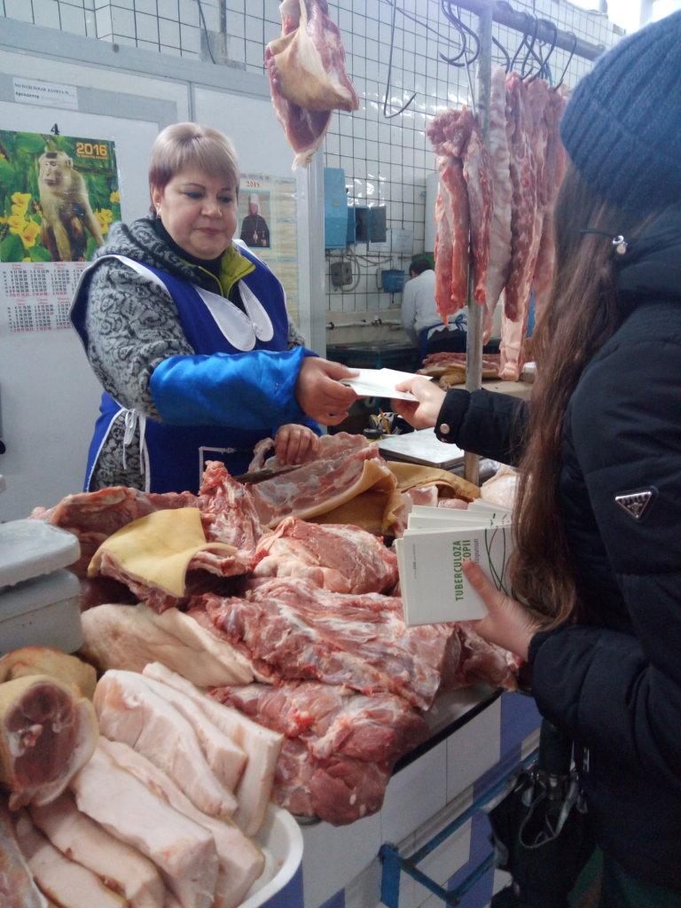 Student Explains TB to Meat Vendor