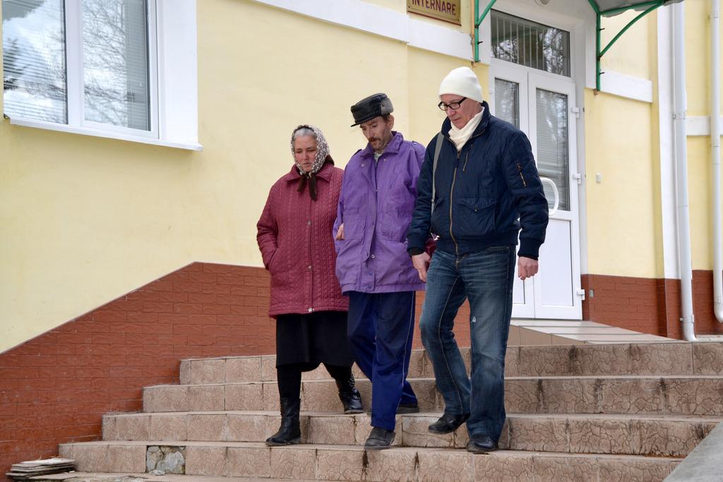 Iulia and Valeri taking Petru for a stroll
