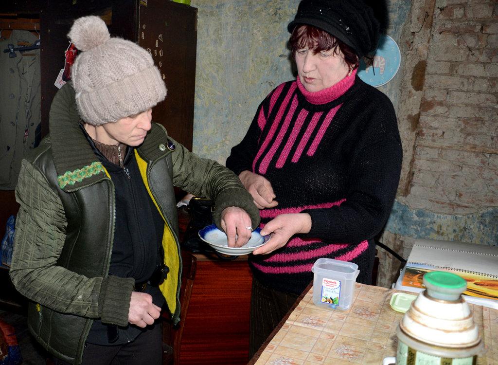 Liudmila takes anti-TB drugs from Galina