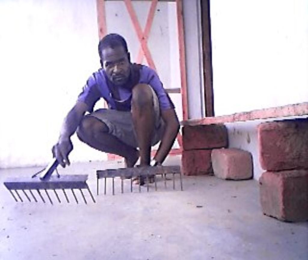 David Prepares Hoes for the Sibunimba Garden