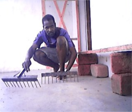 David Prepares Hoes for the Sibunimba Garden