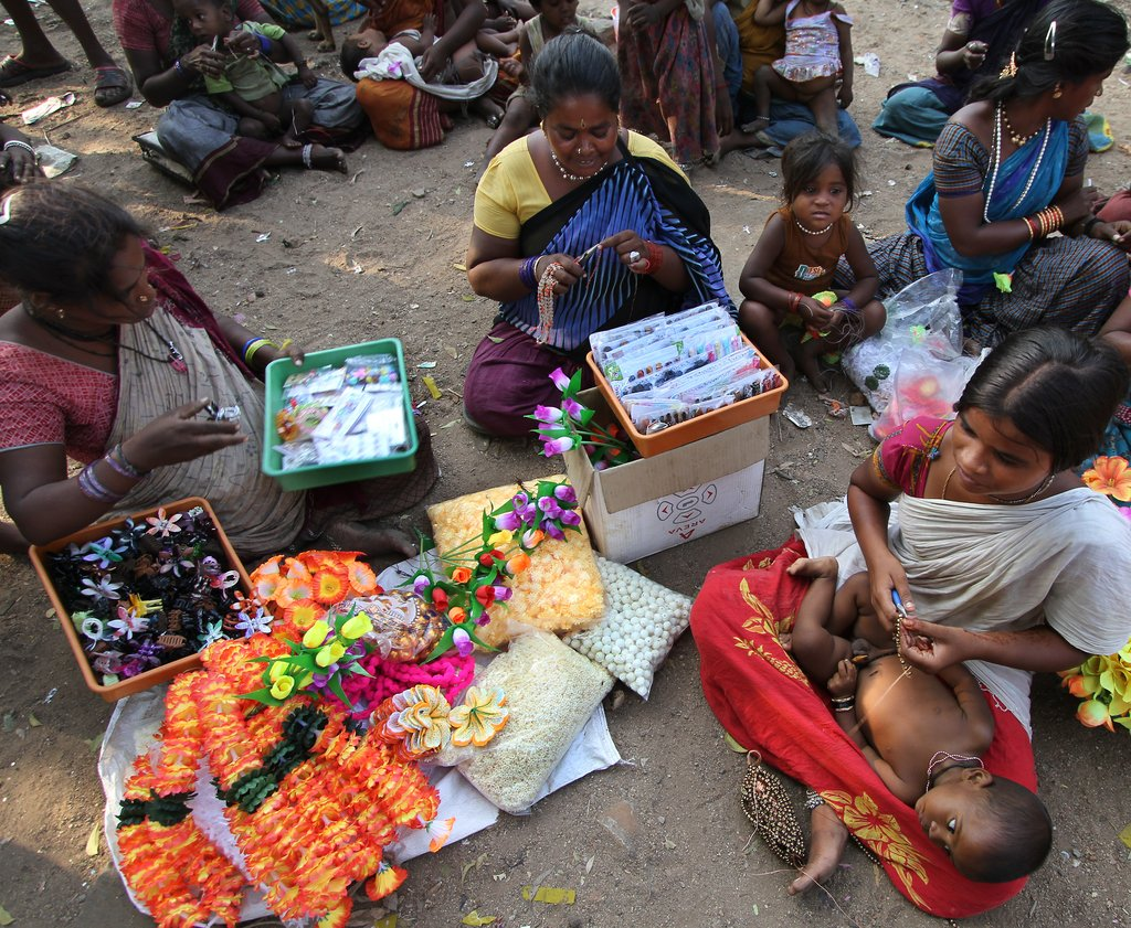 Deepa teaching others to make jewlery