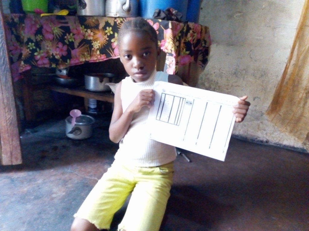 A Little Girl Proud of her School Report