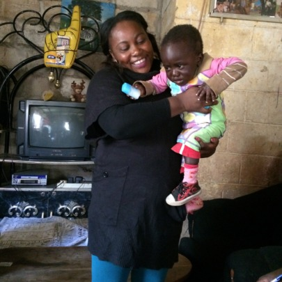 A child with our community health worker