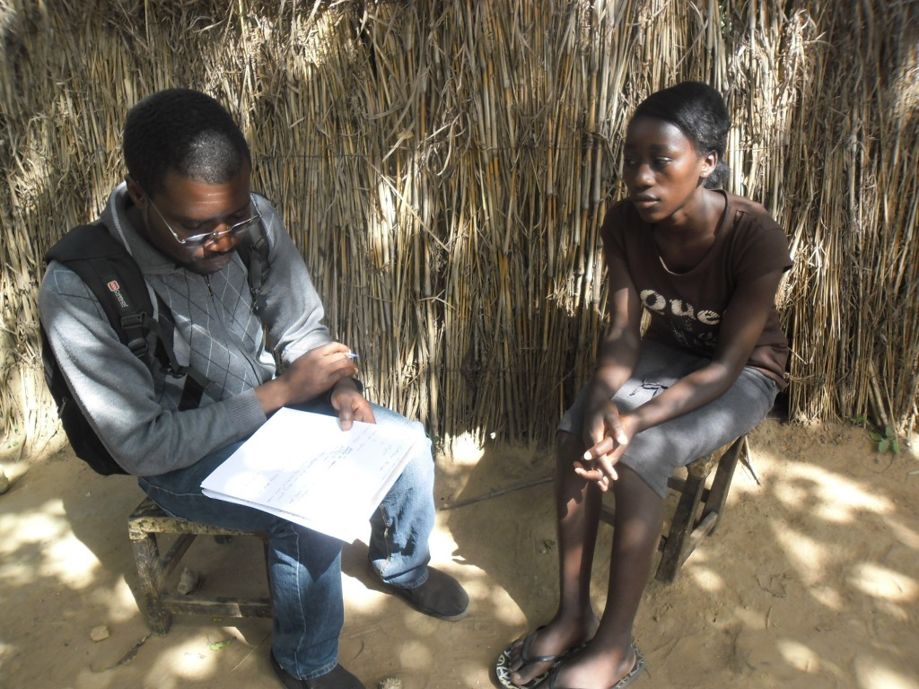 A young boy in conversation with a health worker