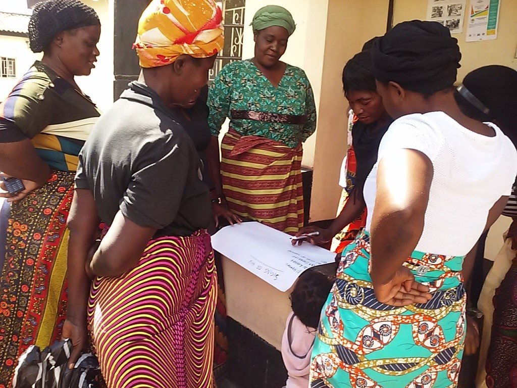 Women learning about HIV prevention and care