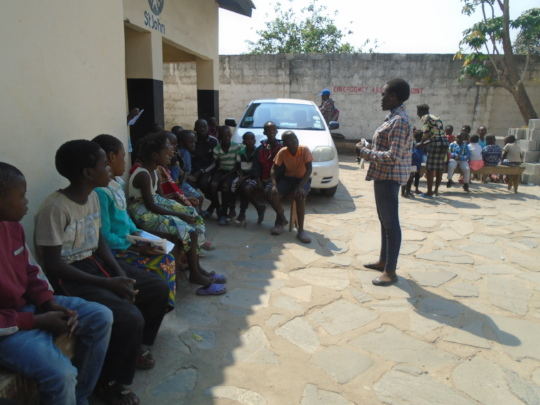 One of the children leading a workshop on HIV
