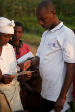 Daniel with Clients in Rwanda